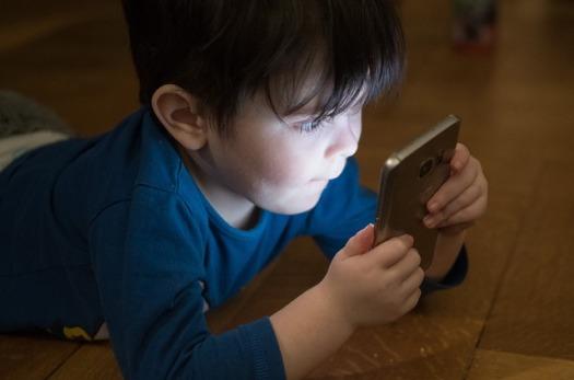 Boy Staring At A Phone